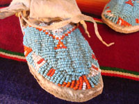 Native American Indian beadwork baby mocassins, Lakota or Cheyenne, c. 1890-1900. The beadwork is fantastic and is in great condition. A closeup of the beadwork on one of the mocassins.