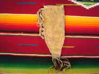 Native American Indian beadwork and folk art, a Plains knife-sheath with ghost-dance designs and symbolism, c. 1890-1910. The sheath is sinew sown with brain-tanned leather, and with fringe and bottom-tassles with beads. Photo showing the back side of the sheath.