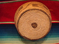 Native American Indian antique basket, a very beautiful, small Pima basket with geometric designs, Arizona, c. 1920. The Pima basket is well-woven (16 stiches per inch) and is very beautiful. Photo of the bottom of the Pima Indian basket.