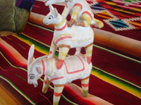 Mexican vintage folk art, and Mexican vintage pottery and ceramics, a whimsical pottery figurine featuring three animals, stacked on each others' backs, attributed to the great Heron Martinez, Acatlan, Puebla, c. 1940-50's. Closeup photo of the Heron Martinez piece showing the goat at the bottom of the stacked animals.