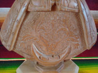 Mexican vintage devotional art, and Mexican vintage woodcarving, a lovely woodcarving of Our Lady of Good Health, Patronness of the Basilica in Patzcuaro, Michoacan, c. 1950's. Closeup photo of the incised detail of Our Lady's garments.