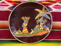Mexican vintage pottery and ceramics, a beautiful black-ware plate with a wonderful rural scene featuring a Mexican woman carrying pineapples to market and accompanied by her loyal doggie, Tlaquepaque or Tonala, Jalisco, c. 1930-40's. Main photo of the plate.