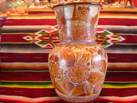 "Mexican vintage pottery and ceramics, a very beautiful pottery olla (jar or vase) with exquisite hand-painted decorations, canela (cinammon colors), by the famous master of Mexican pottery and folk art, ""Pajarito"", Tonala, Jalisco, c. 1950's. Main photo of the olla."