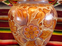 "Mexican vintage pottery and ceramics, a very beautiful pottery olla (jar or vase) with exquisite hand-painted decorations, canela (cinammon colors), by the famous master of Mexican pottery and folk art, ""Pajarito"", Tonala, Jalisco, c. 1950's. Closeup photo of one side of the olla."