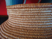 Native American Indian antique baskets, a beautiful polychrome Chemehuevi olla, c. 1920.  A closeup photo of the Chemehuevi Indian basket, showing the tightness of the weave.