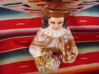 Mexican vintage devotional art, and Mexican vintage pottery and ceramics, a lovely chalk or plaster-art wall-hanging depicting the Santo Nino de Atocha, with glass eyes and with eye-lashes, c. 1940's. Photo shot from above and looking down at the figure.