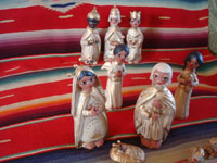 Mexican vintage folk art, and Mexican vintage devotional art, a pottery nativity set with white and gold decoration, Tlaquepaque, Jalisco, c. 1950's. Photo of the Holy Family, part of the nativity set from Tlaquepaque.