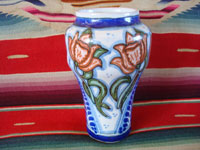 Mexican vintage pottery and ceramics, a beautiful Talavera urn or vase with rich royal blue and soft rose colored glaze decorations, Puebla, c. 1940's. Another side view of the Talavera vase.