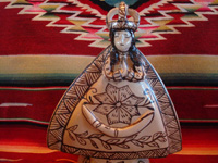 Mexican pottery and ceramics, and Mexican devotional art, a pottery statue of Our Lady of Good Health, from Tzintzuntzan, Michoacan, c. 1980. The piece is in the traditional style of Tzintzuntzan, with a cream-colored background glaze and black (dark-brown) designs. Closeup photo of Our Lady's face.