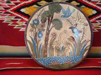 Mexican vintage pottery and ceramics, a petatillo (cross-hatching in the background resembling a straw mat or petate) plate with very fine artwork, attributed to the famous artist Balbino Lucano, Tlaquepaque, Jalisco, c. 1930. Main photo of the pottery plate attributed to Balbino Lucano, Tlaquepaque, c. 1930's.