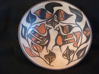 Native American Indian pottery and ceramics, a medium/large dough bowl from Santo Domingo Pueblo, c. 1970-80. The designs painted on the bowl are very beautiful and feature wonderful birds and foliage. Main photo of the Indian pottery bowl.