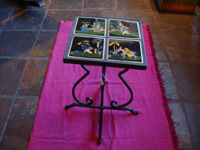 Mexican vintage pottery and ceramics, a wrought-iron table with four matching black-ware tiles, the tiles from Tlaquepaque, Jalisco, c. 1930's. Main photo of the tile-top table.