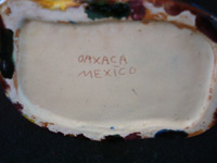 "Mexican vintage pottery and ceramics, a lovely drip-ware vase (losa gotiada) from Oaxaca, c. 1930's. This pottery is also referred to as ""Mexican Majolica"", and was produced in Oaxaca until about 1940. Photo showing the bottom of the vase with its mark."