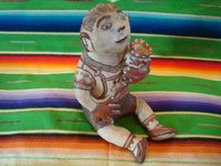 Mexican folk art, and Mexican vintage pottery and ceramics, a beautiful pottery figure of a seated man, with wonderful hand-painted decorations, Amalyatepec, Guerrero, c. 1970. Main photo.