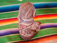Mexican folk art, and Mexican vintage pottery and ceramics, a beautiful pottery figure of a seated man, with wonderful hand-painted decorations, Amalyatepec, Guerrero, c. 1970. Photo showing the back side of the Guerrero figure.