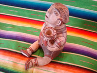 Mexican folk art, and Mexican vintage pottery and ceramics, a beautiful pottery figure of a seated man, with wonderful hand-painted decorations, Amalyatepec, Guerrero, c. 1970. Another side view of the seated Guerrero figure.
