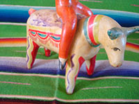 Mexican vintage folk art, and Mexican vintage pottery and ceramics, a wonderful piece of folk art, depicting three acrobats balancing atop a bull, attributed to the great Heron Martinez, Acatlan, Puebla, c. 1950's. Photo of the bull at the base of the piece.