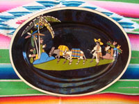 Mexican vintage pottery and ceramics, a black-ware, oval charger with exquisite and very endearing artwork, Tlaquepaque or Tonala, Jalisco, c. 1930's. Main photo of the Tlaquepaque pottery charger.