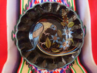 Mexican vintage pottery and ceramics, a stunningly beautiful blackware pottery plate with exquisite artwork, featuring a lovely exotic bird, Tonala or Tlaquepaque, Jalisco, c. 1920-30's. Main photo of the front of the Tlaquepaque pottery plate.