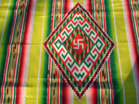 Mexican vintage textiles and Saltillo sarapes, a spectacular Saltillo sarape (serape) with wonderful colors and a whirling-log in the center medallion, Mexico, c. 1910-20's. Closeup photo showing the center medallion of the Saltillo sarape.