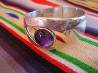 Mexican vintage sterling silver jewelry, and Taxco vintage silver jewelry, a beautiful silver bracelet with an amethyst cabochon, signed SIGI (Sigi Pineda), Taxco, c. 1940's. Side view of the Taxco silver jewelry bracelet by Sigi Pineda.