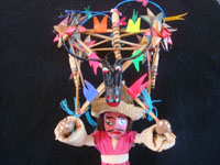 Mexican vintage folk art, a wonderful folk art figure of a bull-dancer made of wood, cornhusks, string, straw and ribbons, c. 1950's or earlier. Closeup photo of the bull atop the bull-dancer.