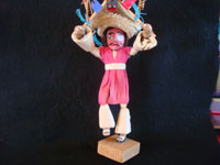Mexican vintage folk art, a wonderful folk art figure of a bull-dancer made of wood, cornhusks, string, straw and ribbons, c. 1950's or earlier. Closeup photo of the dancer himself.