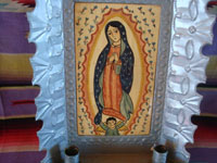 New Mexican vintage devotional art, and New Mexican vintage folk art. a wonderful retablo depicting Our Lady of Guadalupe, done on hand-adzed wood with a surrounding stamped tinwork-art frame, New Mexico, c. 1990. A closer look at the painting of Our Lady of Guadalupe.