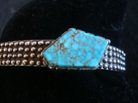 "Native American Indian sterling silver jewelry, and Navajo vintage silver jewelry, a very beautiful Navajo silver bracelet with a wonderful ""off-set"" turquoise stone, Arizona or New Mexico, c. 1950's. Closeup photo of the turquoise, off-set stone."