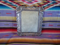 Mexican vintage tinwork art, and Mexican vintage folk art, a lovely mirror with a beautiful repousee silver frame, c. 1940's. Main photo of the mirror.