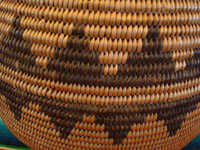 Closeup photo of Native American Indian basket, Chemehuevi olla c. 1910.