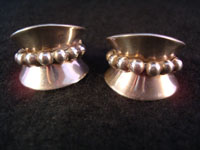 "I-5: Mexican vintage Taxco sterling silver jewelry, earrings with bump-out ball design, c. 1940. Signed ""Taxco Sterling"". Extremely elegant and wonderful craftsmanship. Size: 1"" wide x 3/4"" high. Price: $155."