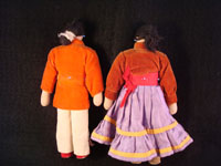 Photo of the backs of the Navajo folk art dolls.