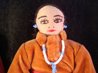 Closeup photo of the face of one of the Navajo folk art dolls.