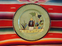 "I-8: Mexican vintage pottery and ceramics, a Tlaquepaque pottery plate with pale green background and wonderful art-work, c. 1930. Size: 10"" diameter. The hand-painted art-work on this plate is phenomenal! The plate has a wonderful squiggle border around the edge. Condition is excellent. Price: $130."