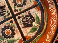 Mexican vintage pottery and ceramics, a wonderful petatillo plate, Tonala, c. 1940's. Closeup photo of floral designs.