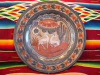 Mexican pottery and folk art, a lovely burnished charger by the late artist Amado Galvan, Tonala, Jalisco, c. 1960's. The charger features lovely deer and wonderful foliage, cactus, and flowers. Main photo.