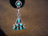 Native American Indian vintage sterling silver jewelry, a pair of Zuni silver earrings with turquoise, c. 1940's.  Closeup photo of one Zuni silver earring.
