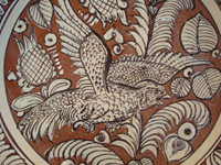 Mexican vintage pottery and ceramics, a beautiful fantasia-ware plate with an incredible scene of a flying eagle, Tonala or Tlaquepaque, Jalisco, c. 1930's. Closeup photo of the eagle on the front of the fantasia plate.
