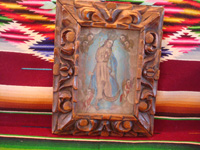 Mexican vintage devotional art, a beautiful oil painting of Our Lady standing on top of the world and surrounded by wonderful angels, c. 1930's. The painting is mounted in a very beautiful, hand-carved wooden frame, c. 1930's. Main photo of the painting.