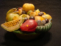 Mexican vintage folk art, and Mexican vintage pottery and ceramics, a pottery bank in the form of a lovely bowl of assorted fruits, Tonala or Santa Cruz de las Huertas, Jalisco, c. 1930's. Another view of the top of the bank.