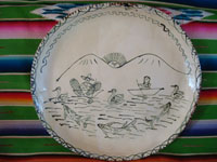 Mexican vintage pottery and ceramics, a large charger featuring a scene of Purepecha natives fishing their whitefish (pescado blanco) on lovely Lake Patzcuaro, Michoacan, c. 1940's. Main photo of the Tzintzuntzan charger.