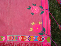 Mexican vintage clothing, and Mexican vintage textiles and huipiles, a vintage huipil of hand-woven cotton with very fine embroidery, Zinacantan, Chiapas, c. 1960's. Closeup photo of the embroidery on the vintage Mexican blouse or huipil.