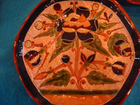 Mexican vintage pottery and ceramics, a very rare and beautiful tea-set, signed by the famous Tonala potter Magdaleno Coldivar Ramos, Tonala, c. 1920-30's. Closeup photo of one saucer.