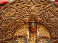 Mexican vintage pottery and ceramics, a wonderful burnished charger with the face of a beautiful maiden between two Olinala trays and against a background of Aztec designs and symbols, Tonala or Tlaquepaque, Jalisco, c. 1930's. Closeup photo of the Aztec designs in the background.