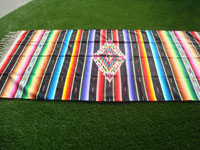 Mexican vintage textiles, and Mexican vintage Saltillo sarapes (serapes), a beautiful, large Saltillo-style sarape with a wonderful central medallion and beautiful color combinations, c. 1930's. A side view of the sarape.