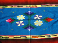 Mexican vintage textiles, and Mexican Saltillo sarapes (serapes), a wonderful Saltillo-style sarape with beautiful flowers serving as the center medallion, and with stunning color combinations creating a rainbow effect, c. 1940's. Closeup photo of the flowers in the center medallion.