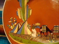 Mexican vintage pottery and ceramics, a beautiful pottery charger with a wonderful glaze in the background and artwork featuring a man going to market with his trusty burros and with a lovely quetzal flying overhead, Tonala or Tlaquepaque, Jalisco, c. 1940's. Another closeup photo of the man and his burro.