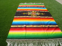 Mexican vintage textiles, and Mexican vintage Saltillo sarapes (serapes), a beautiful Saltillo-style sarape with a beautiful center medallion and a wonderful rainbow effect, c. 1940's. Main photo of the sarape.