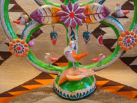 Mexican vintage folk art, and Mexican vintage pottery and ceramics, a wonderful pottery tree-of-life with beautiful and very colorful decorations, Izucar de Matamoros, Puebla, c. 1950's. A closeup photo of the bird near the base of the tree-of-life by Heriberto Castillo.